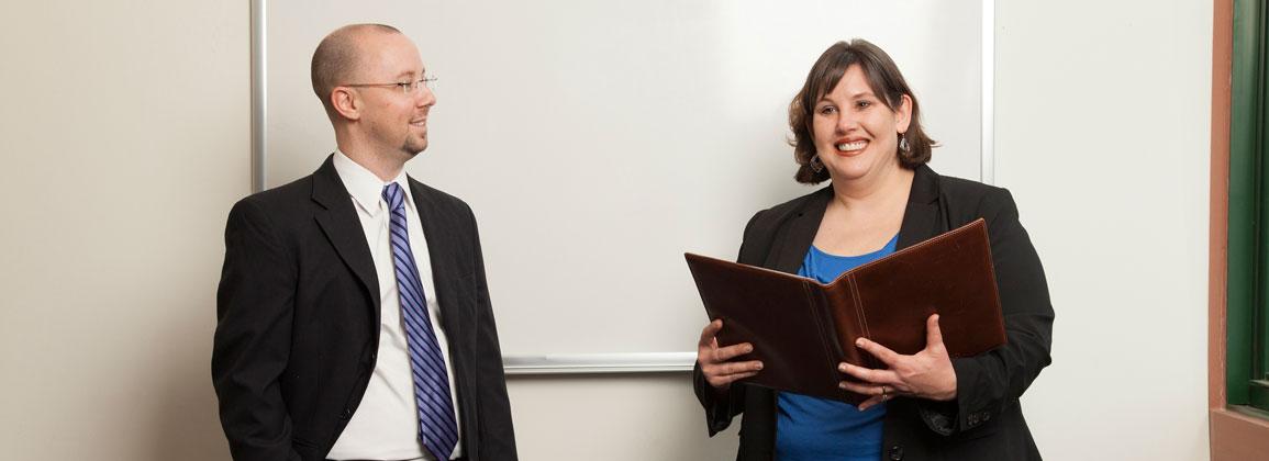 Two associates presenting