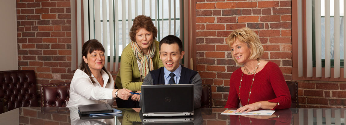 Several associates collaborating on a computer
